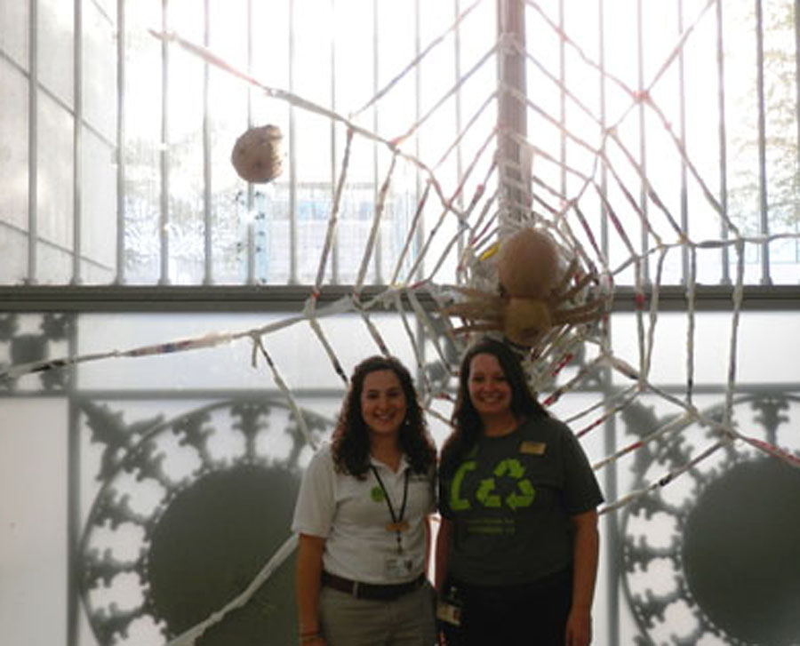 Gillian Rabalais, right, and Melissa Manus show off their wonderful woven web made from 150 recycled plastic bags.